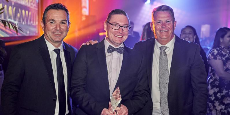 RMS Garth Kay from RMS receives the Best Supplier Award 2019 from Adrian Turner and Stephen Mansfield of Quest Apartment Hotels New Zealand